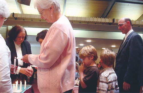 Rev. Mary Moore Lighting Candles